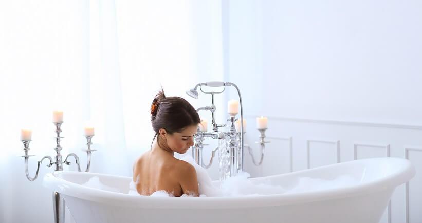 women taking shower in bath tub